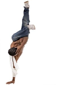 Image of man doing a one handed hand stand