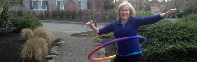 Image of a woman using a hola hoop