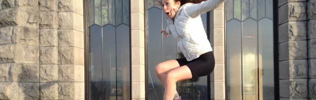 image of girl jumping using hip flexors