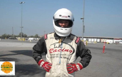 Image of Laura Coleman in race car fire suite