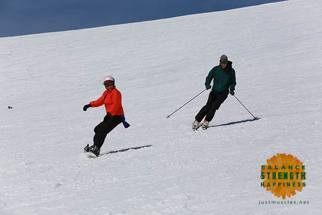 Image of a skier and a snowboarder