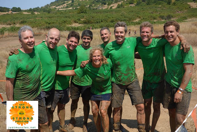 Image of Laura Coleman with team members for Tough Mudder race