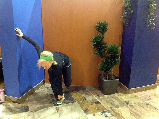 Laura Coleman demonstrating a single leg squat start position
