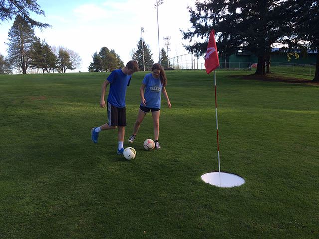 Image of teens playing foot golf