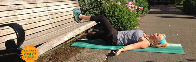 Image of personal trainer Laura Coleman in supine groin stretch position