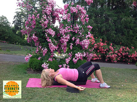 Image of Laura Coleman demonstrating using a foam block for foam roller exercises