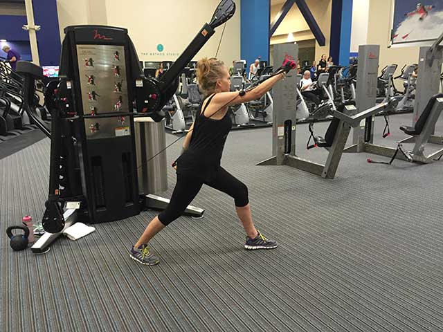 Image of woman doing cable weights exercise