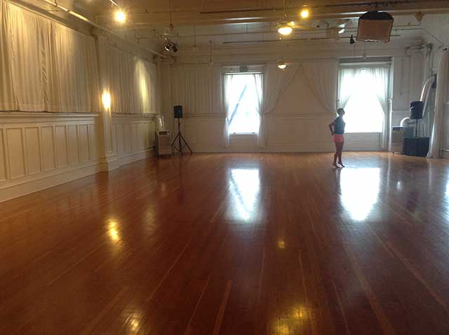 Image of inside of a dance studio with wood flors