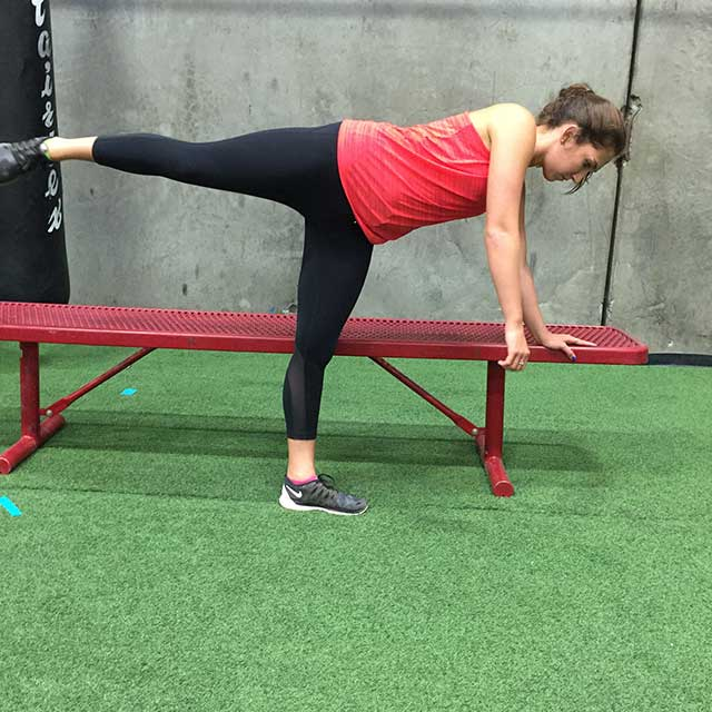 Image of woman doing a standing leg exercise with Laura Coleman