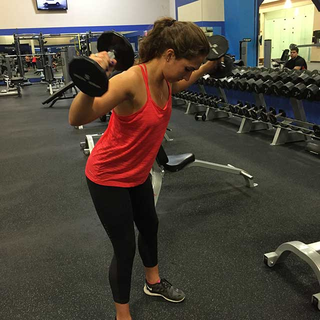 Image of woman doing a standing weight exercise with Laura Coleman