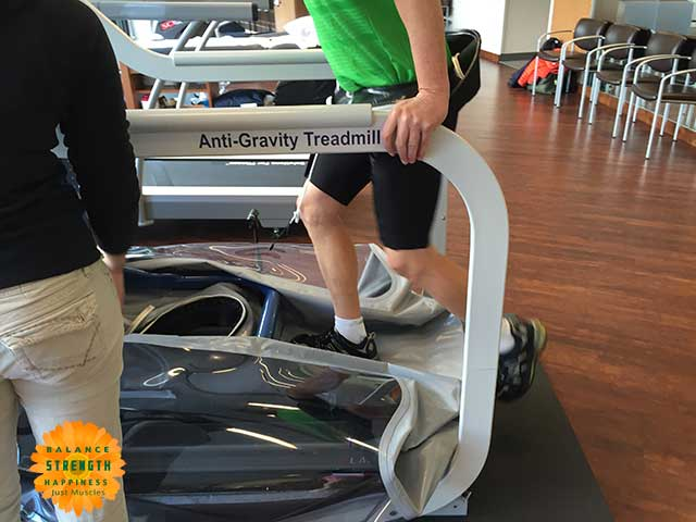 Image of man stepping onto an air treadmill for a workout