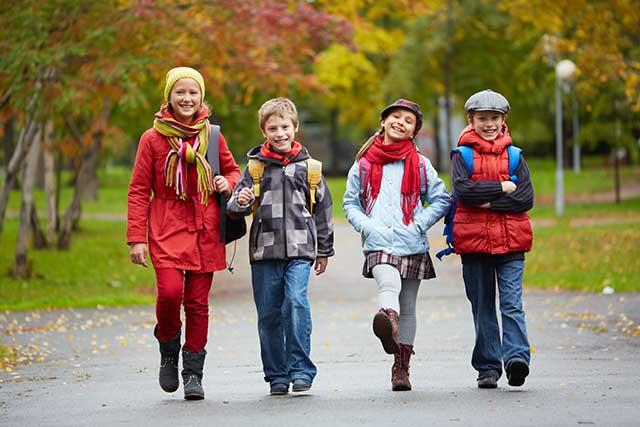 Image of kids walking down a street