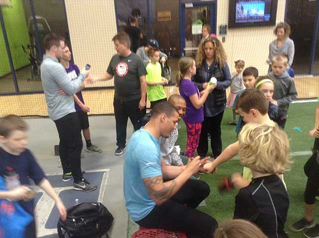 Image of sprinter Ryan Bailey signing autographs