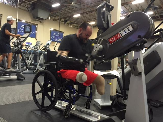 Image of man using arm bike for cardio