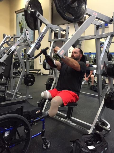 Image of man lifting weights