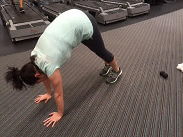 Image of person doing an inchworm exercise