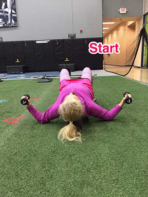 Image of Laura Coleman demonstrating helicopter exercise for stomach and abs
