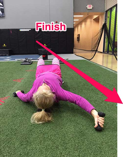 Image of Laura Coleman demonstrating the hitchhiker exercise for shoulders and abs how to finish