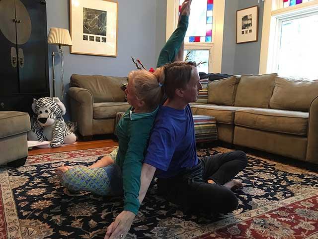 image of partner yoga shoulder chest stretch position 3