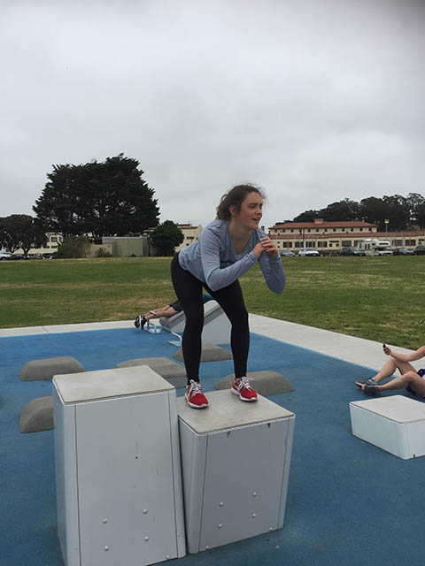 image of girl doing box squats