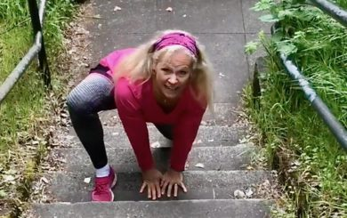 image of Laura Coleman Waite starting a bear crawl up stairs